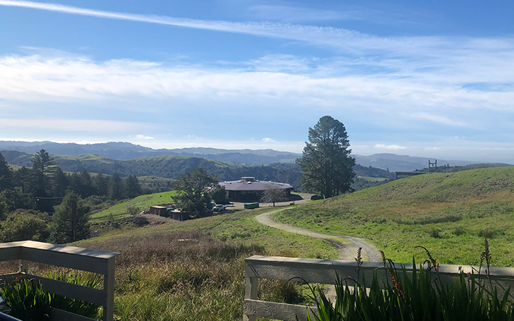 Photo of Djerassi retreat house and surrounding hillside during day